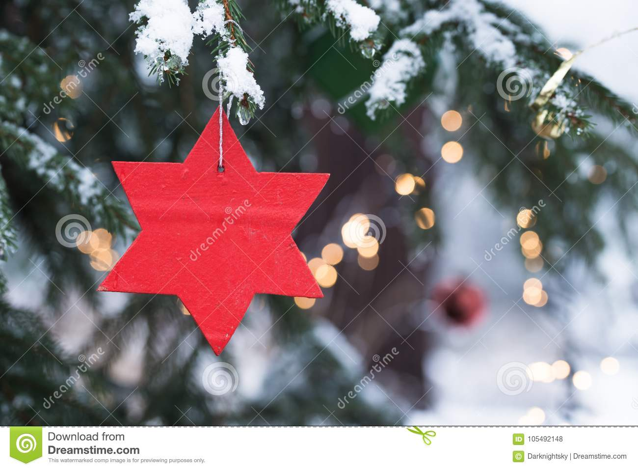 Winter Season Christmas Tree With Snow And Candles Stock Photo