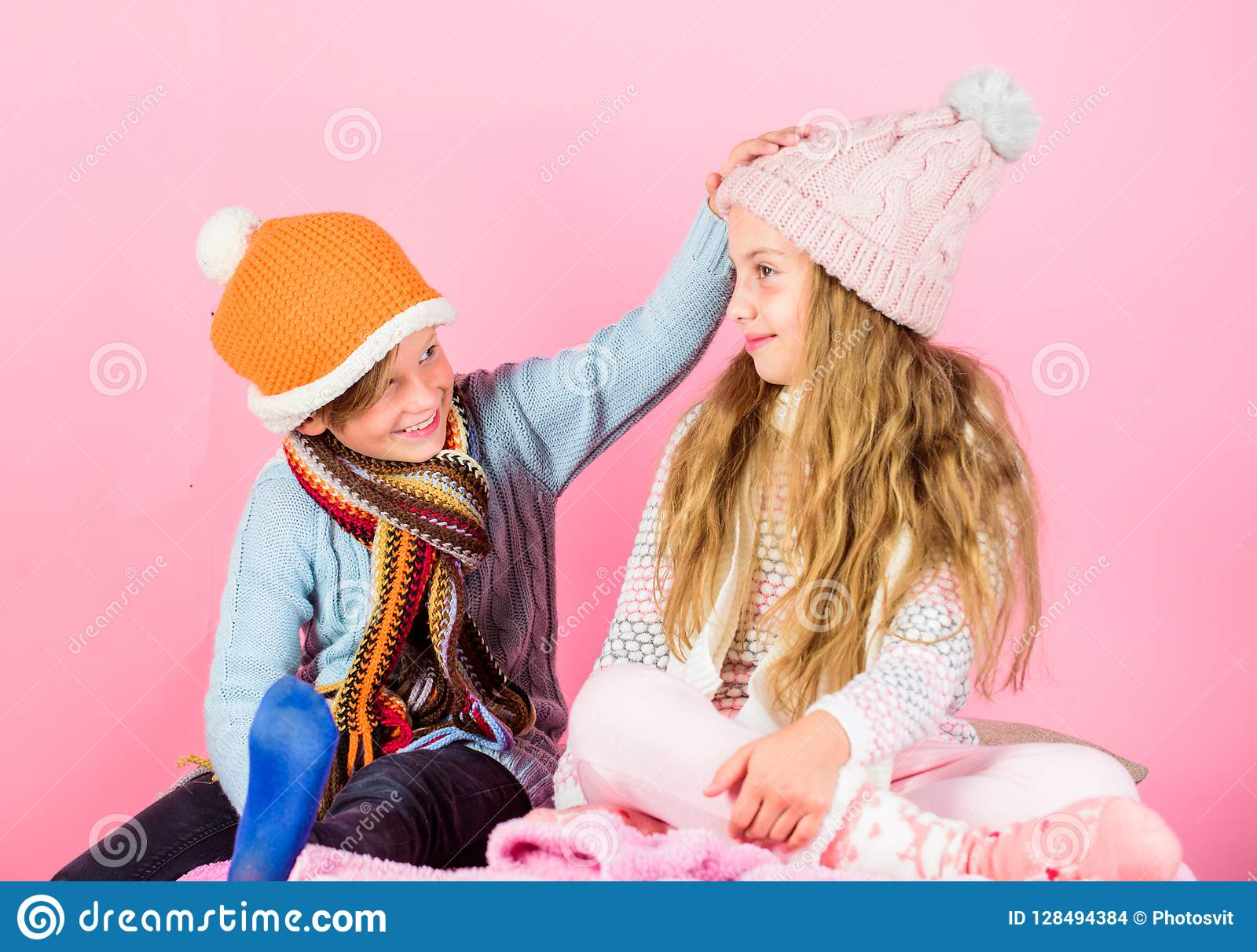 Winter season fashion accessories and clothes. Kids knitted winter hats. Children playful mood christmas holidays pink