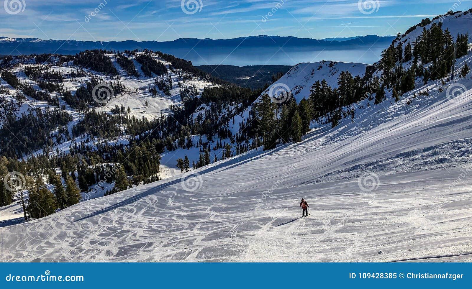 downhill skiing at alpine meadows ski resort above lake tahoe stock