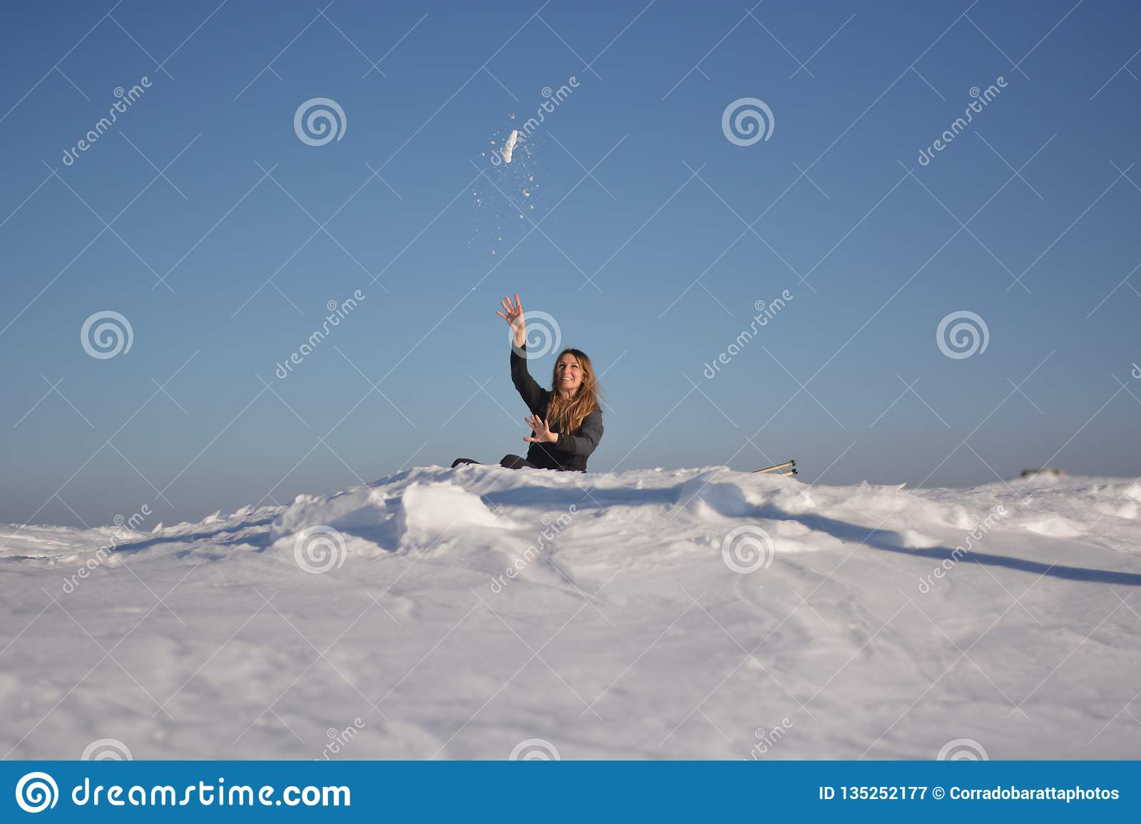 Driven By Winter Wind >> The Girl Plays Pulling Snowballs From Behind A Wind Driven Dune