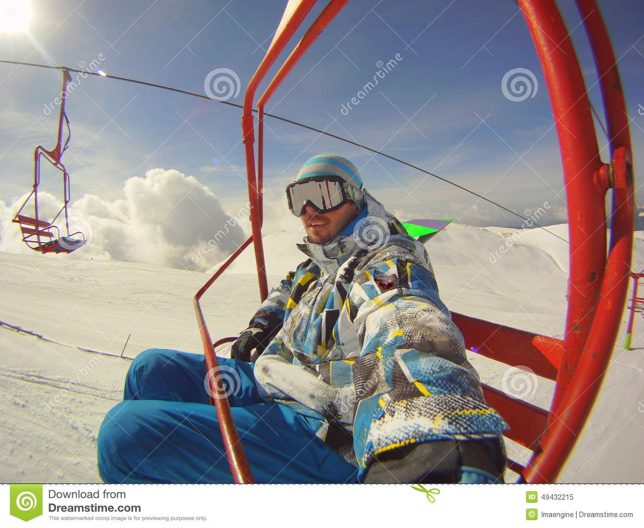 Winter sports - skier using cable car