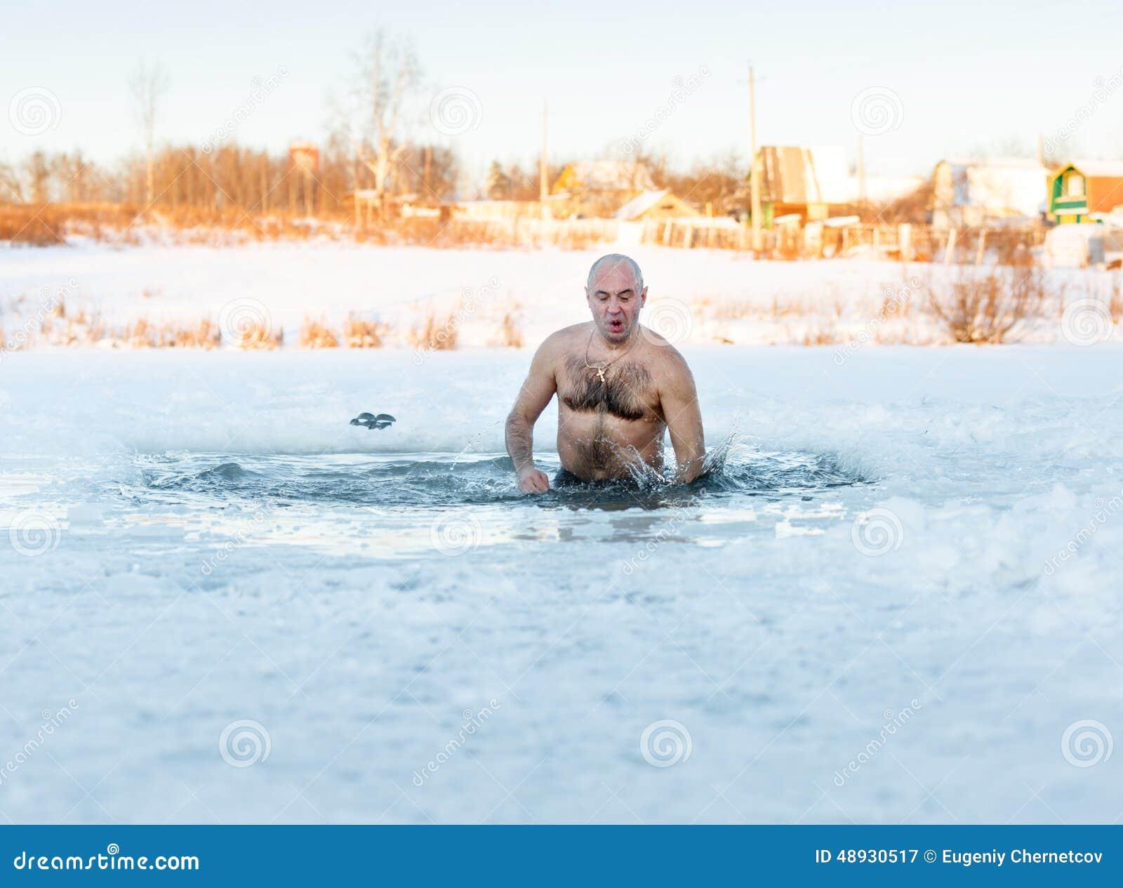Winter Swimming. Man In Ice-hole Stock Photo