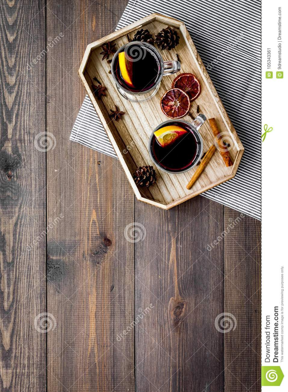 Winter tea with citrus and spices on dark wooden background top view copyspace