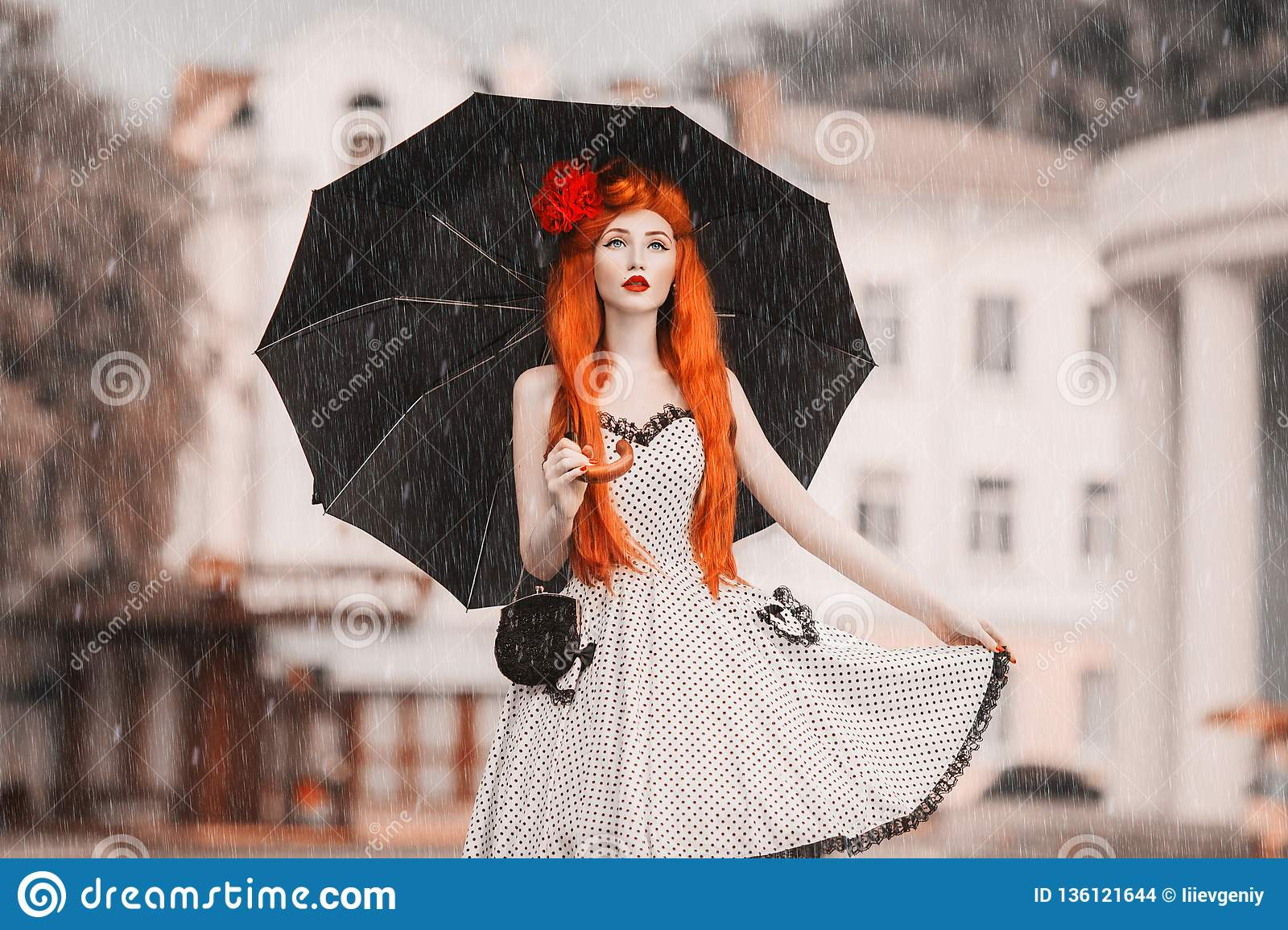 Winter weather. Autumn snow. Lonely unhappy girl in retro dress hold black umbrella. Raining in city. Wet umbrella against the