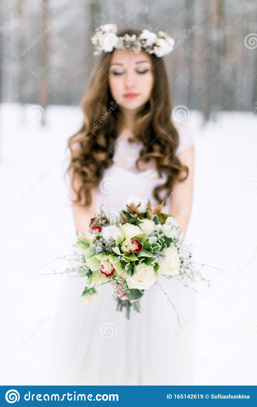 Winter Wedding Flower Bouquet With Cotton Young And Beautiful Bride With The Flower Bouquet In Winter Forest Focus On Stock Image Image Of Female Cold 165142619