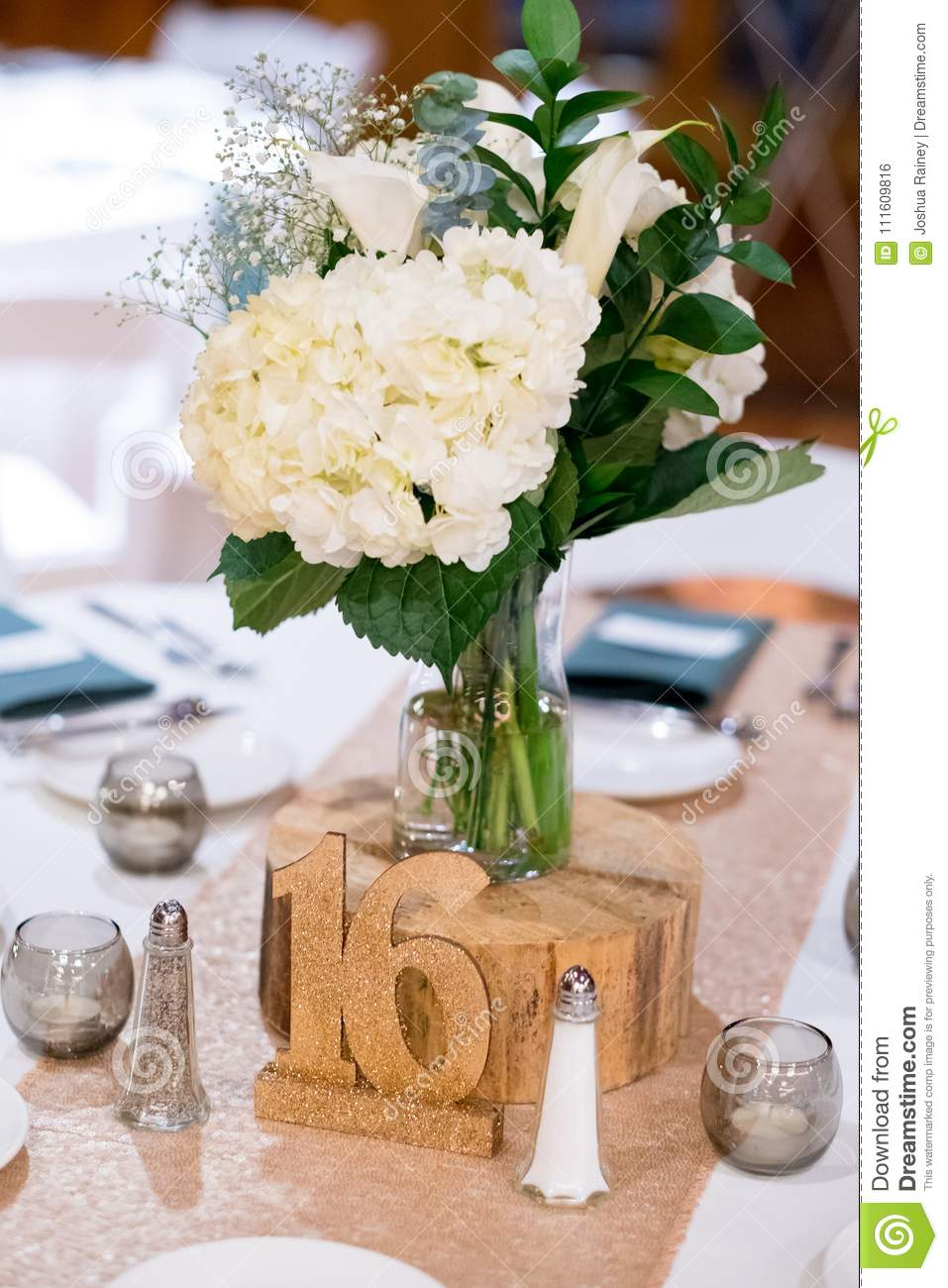 Wedding centerpieces at reception stock photo image of beautiful winter wedding reception with beautiful flower centerpieces and number seating assignment tags in oregon izmirmasajfo