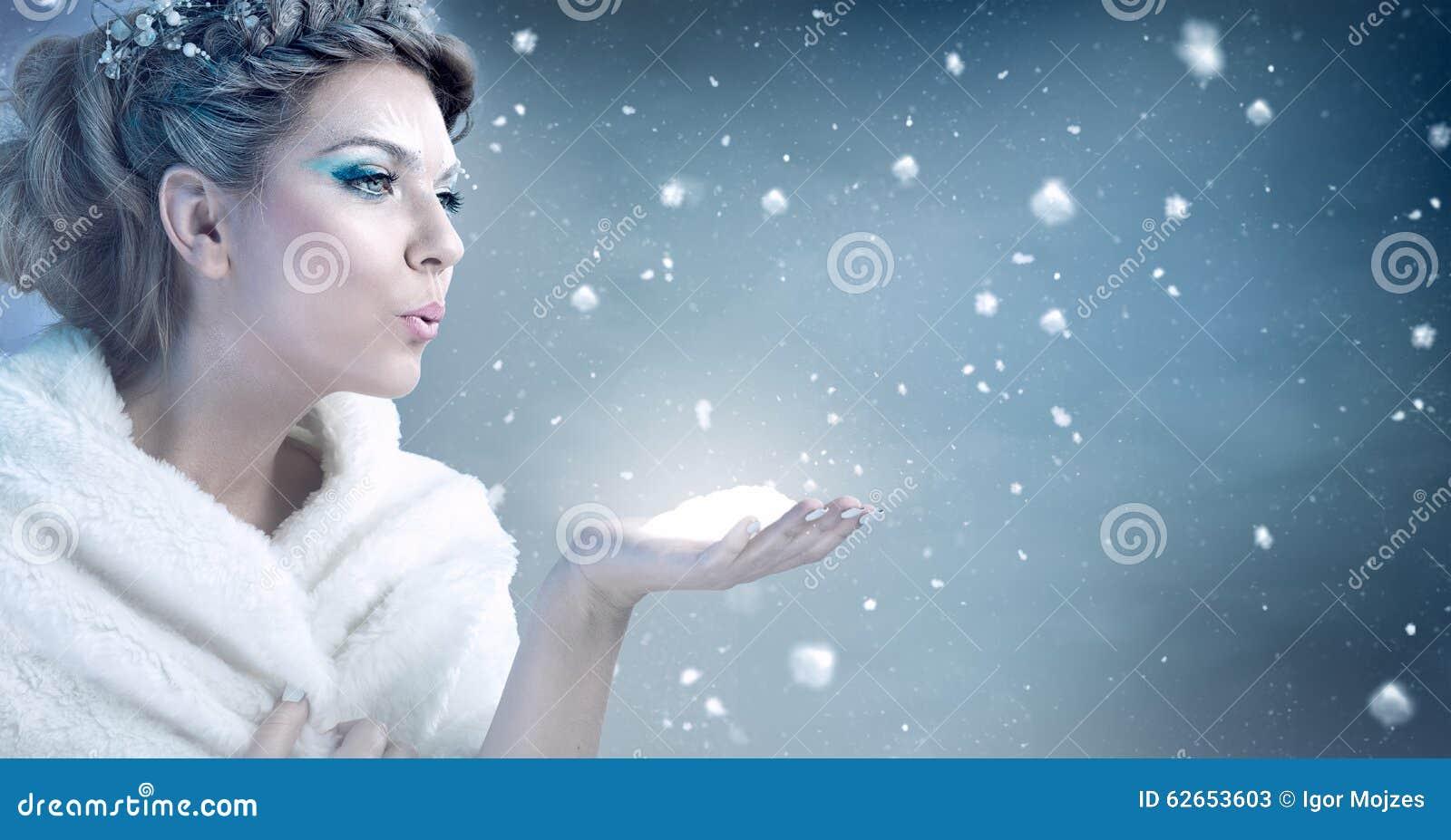 Winter woman blowing snow - snow queen