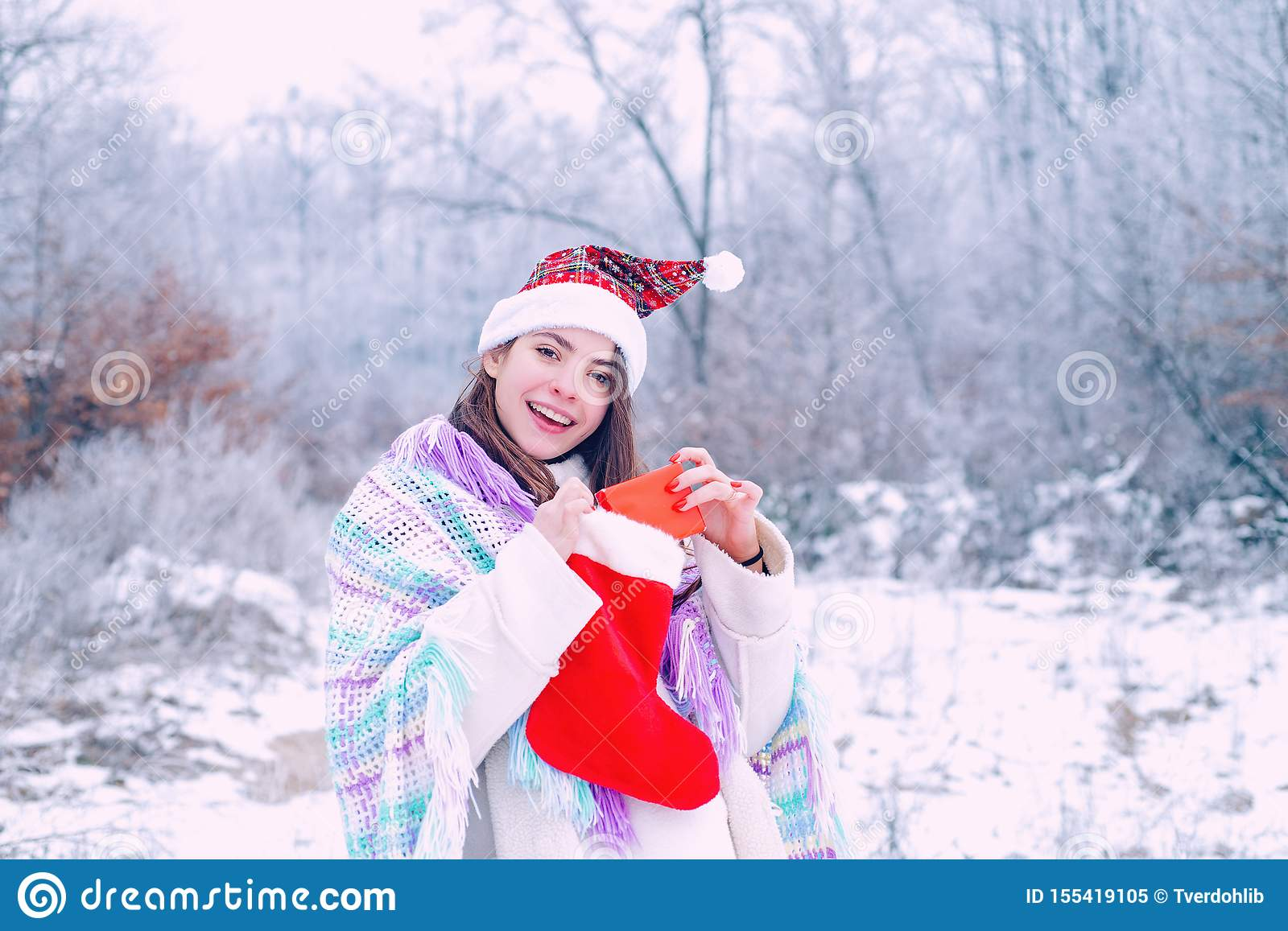 Winter woman. Gift on winter holiday. Girl with present gift in winter park. Suprise in winter day.