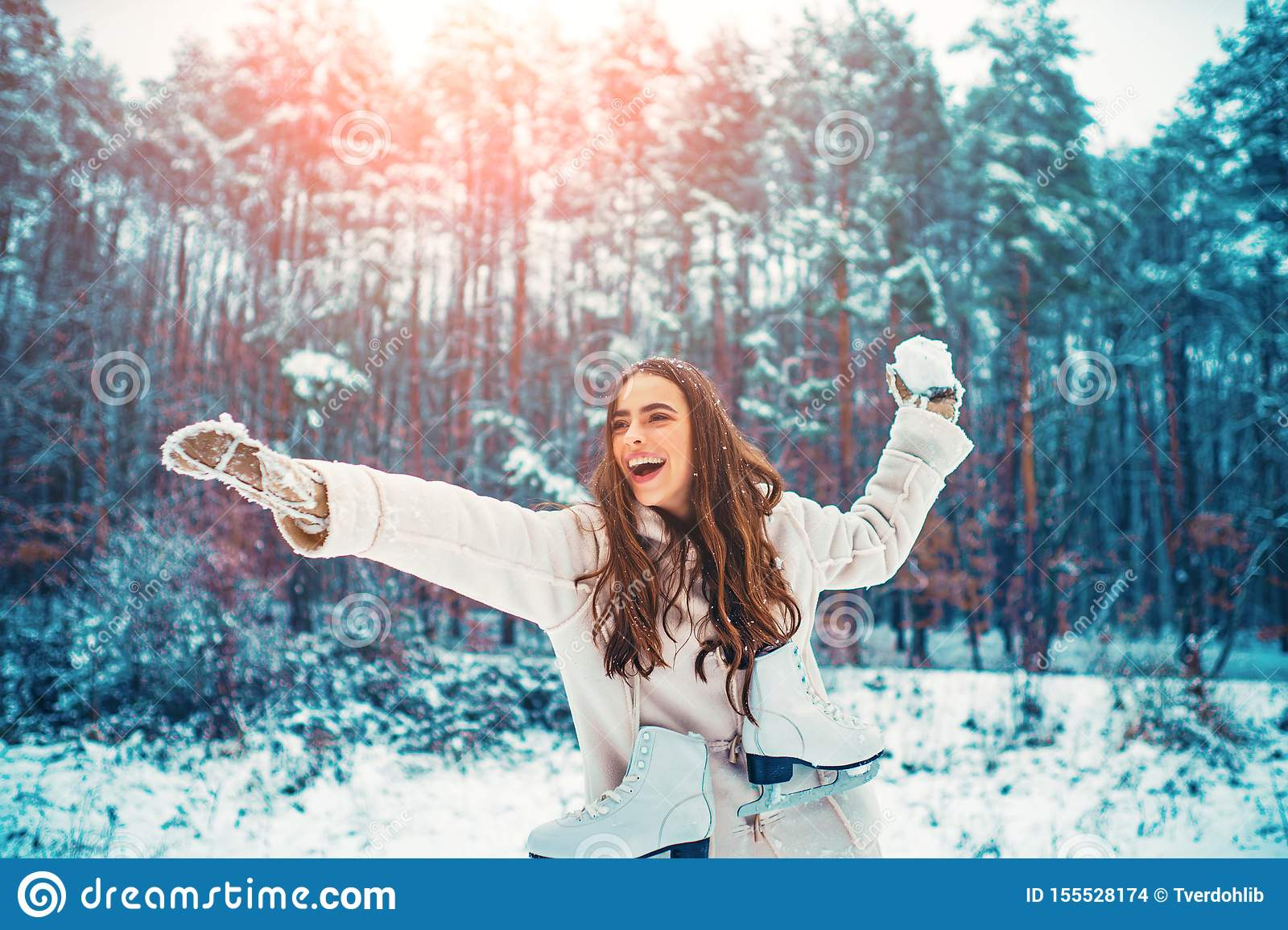 Winter woman. Outdoor portrait of young beautiful girl with long hair.