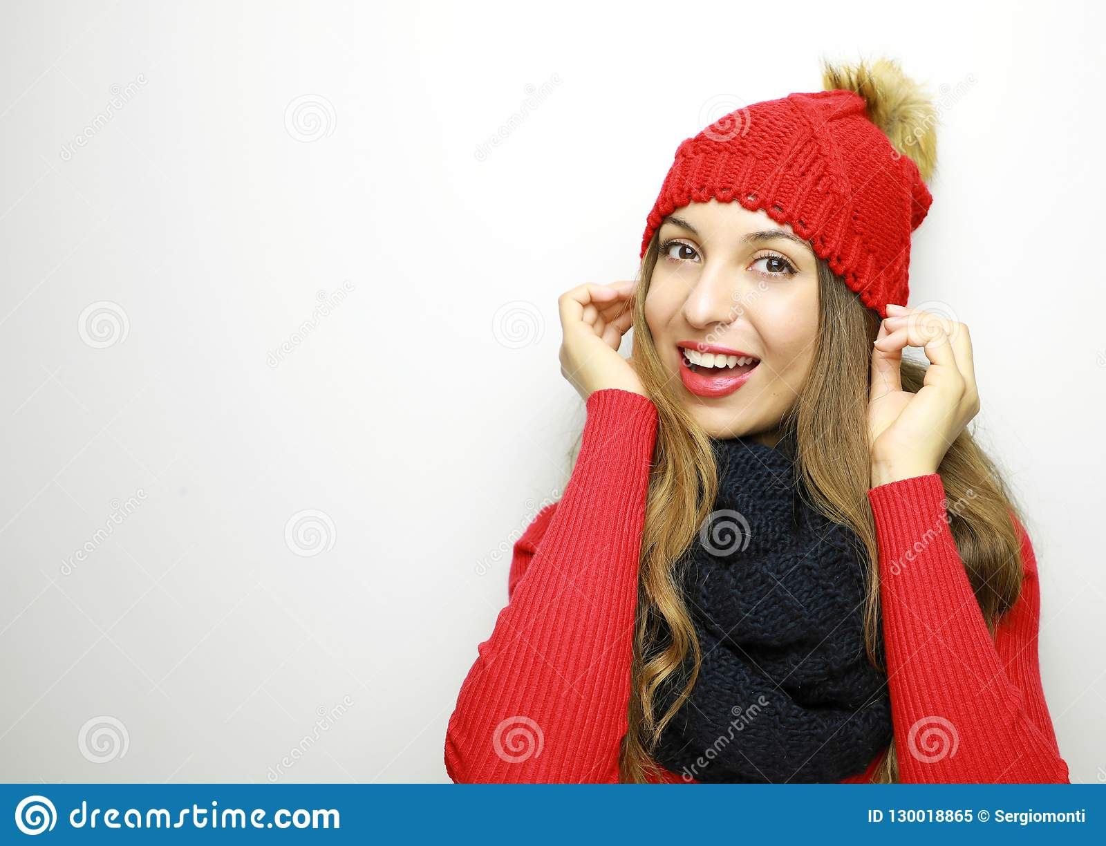Winter Woman With Wool Hat With Pompon Smiling At Camera On Whit