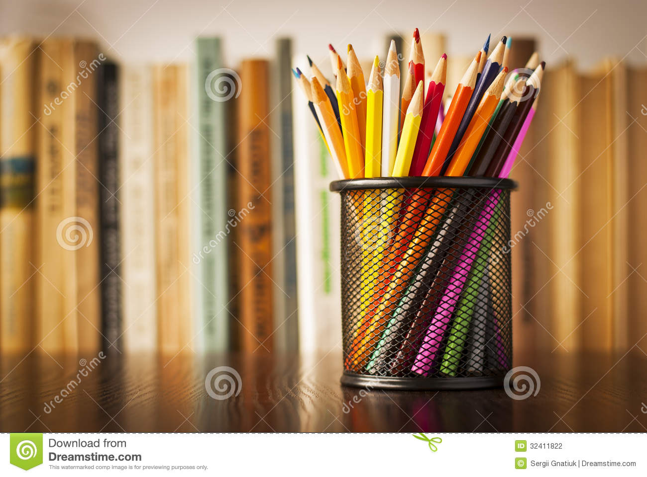 ... wooden table in front of a bookshelf full of books with shallow dof
