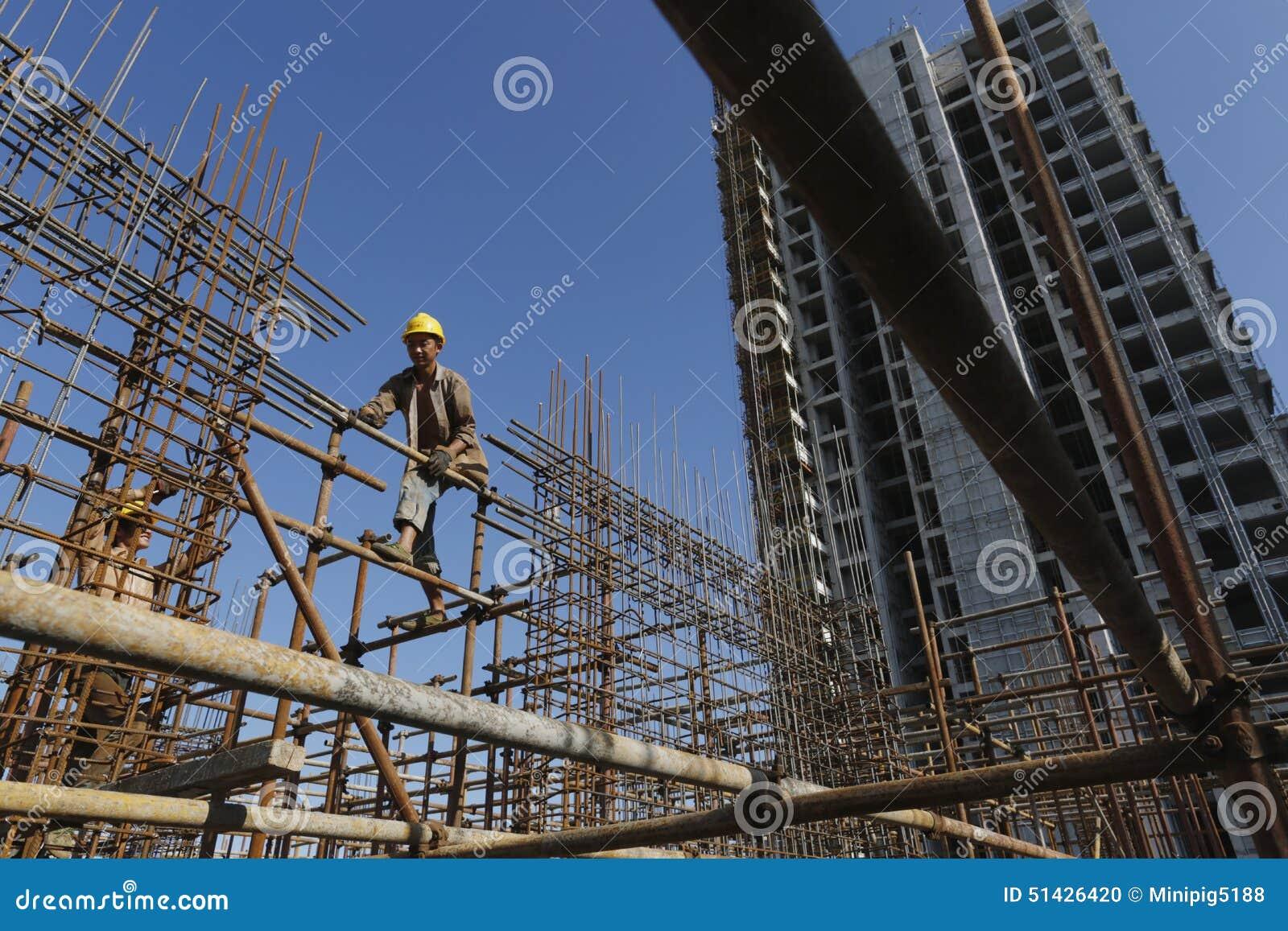 Bar Ties Construction : Construction worker ties reinforcing steel stock photo