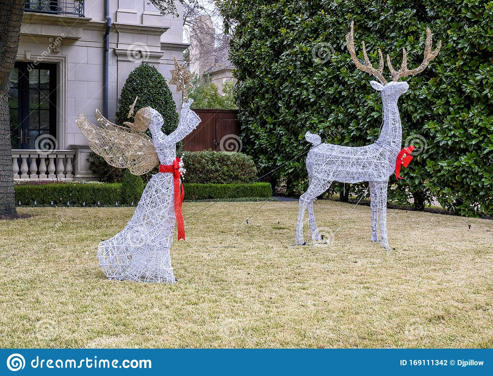 Wire White Angel And Reindeer Christmas Decorations In The