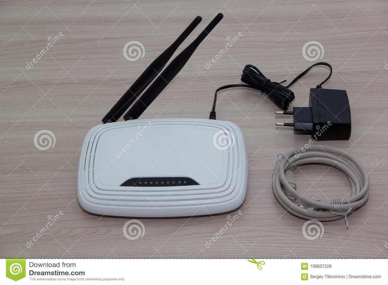 Wireless Router With Two Antennas Is Lying On A Wooden Desk. Modern ...