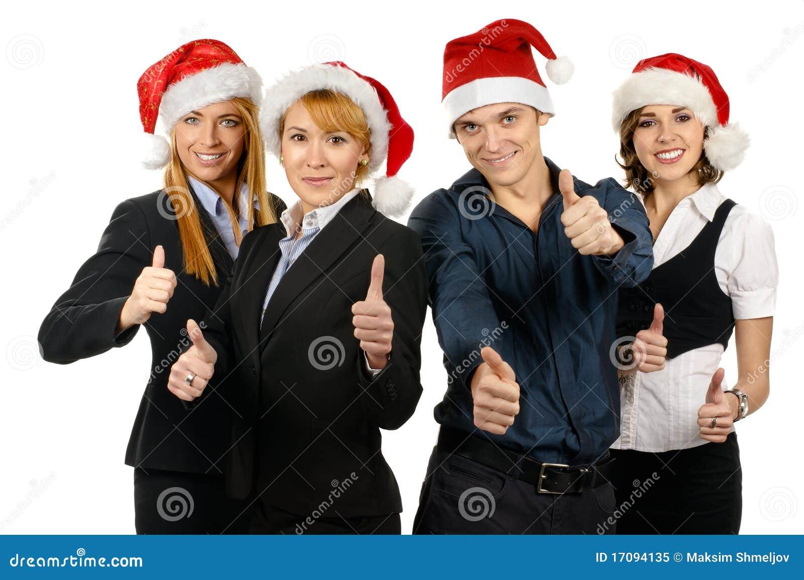 Wirtschaftler mit vier Jungen in den Weihnachtshüten