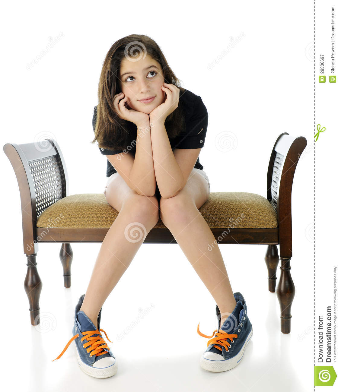 pretty preteen girl wistfully sitting on a bench with her head ...: dreamstime.com/royalty-free-stock-photography-wistful-tween...