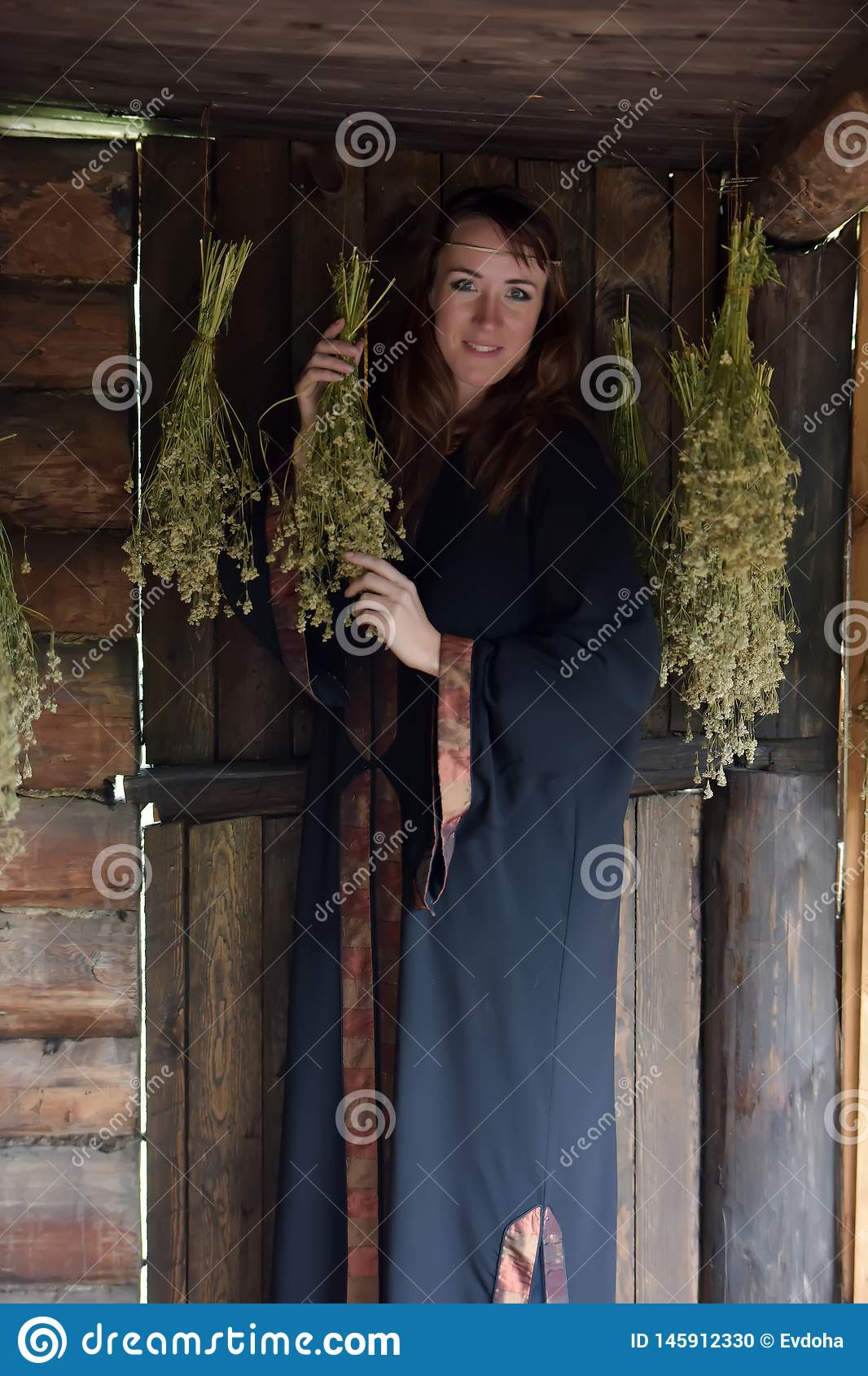 Healer with dried herbs