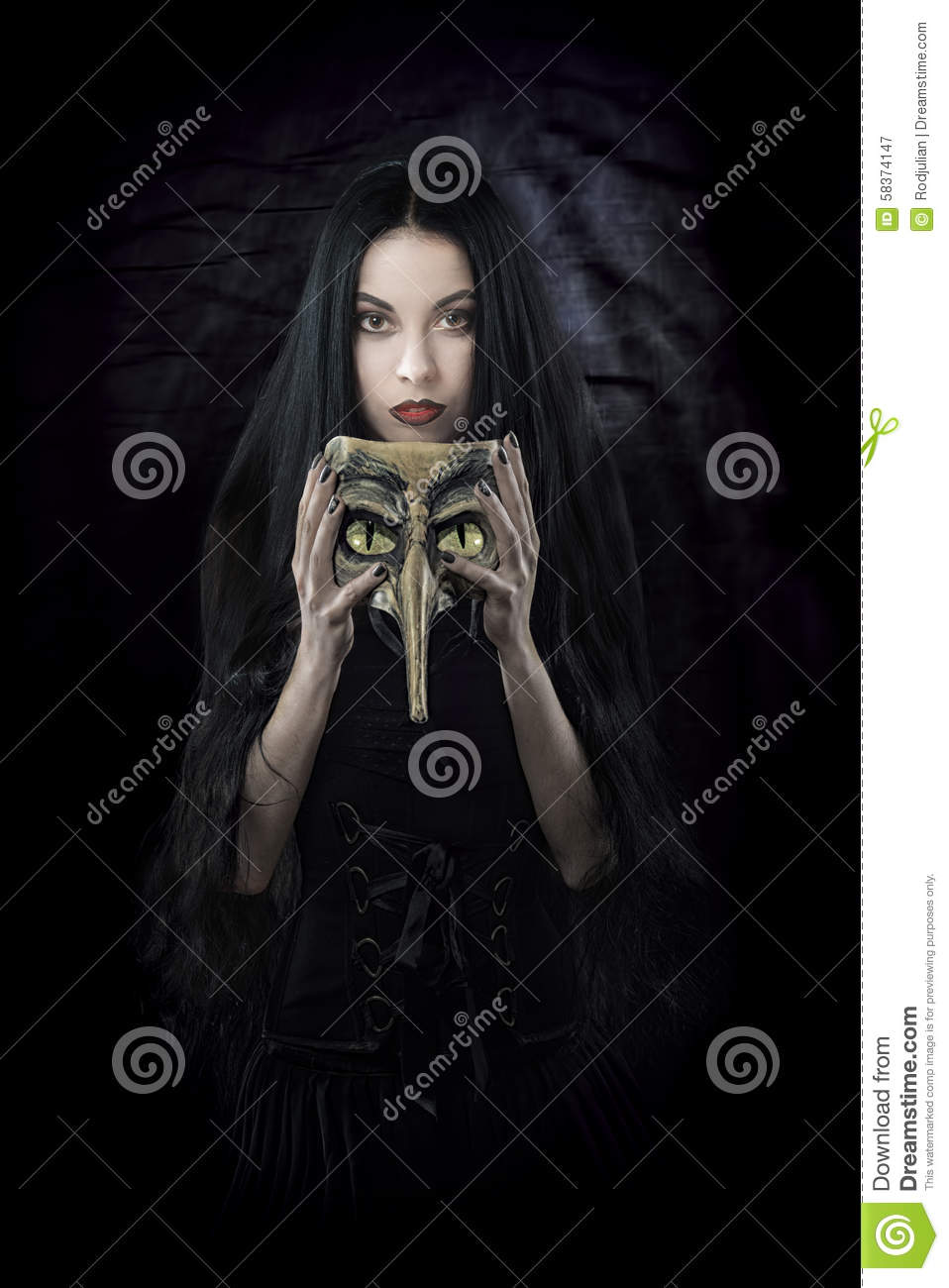 Witch holding a mask