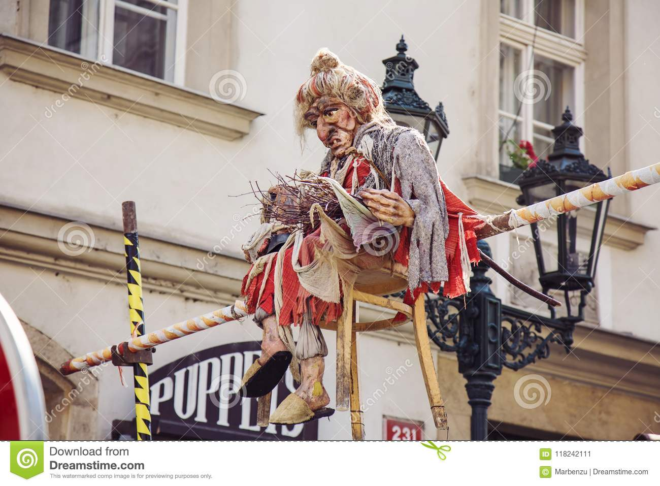 Witch Puppet Sitting Above The Street Next To Prague Puppet Boutique