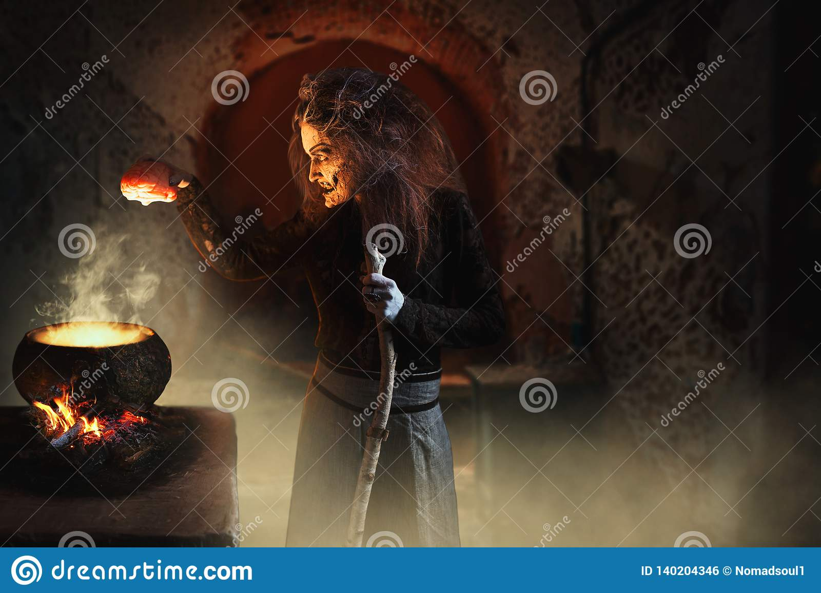 Witch Reads Spell Over Pot With Human Body Parts Stock Photo - Image