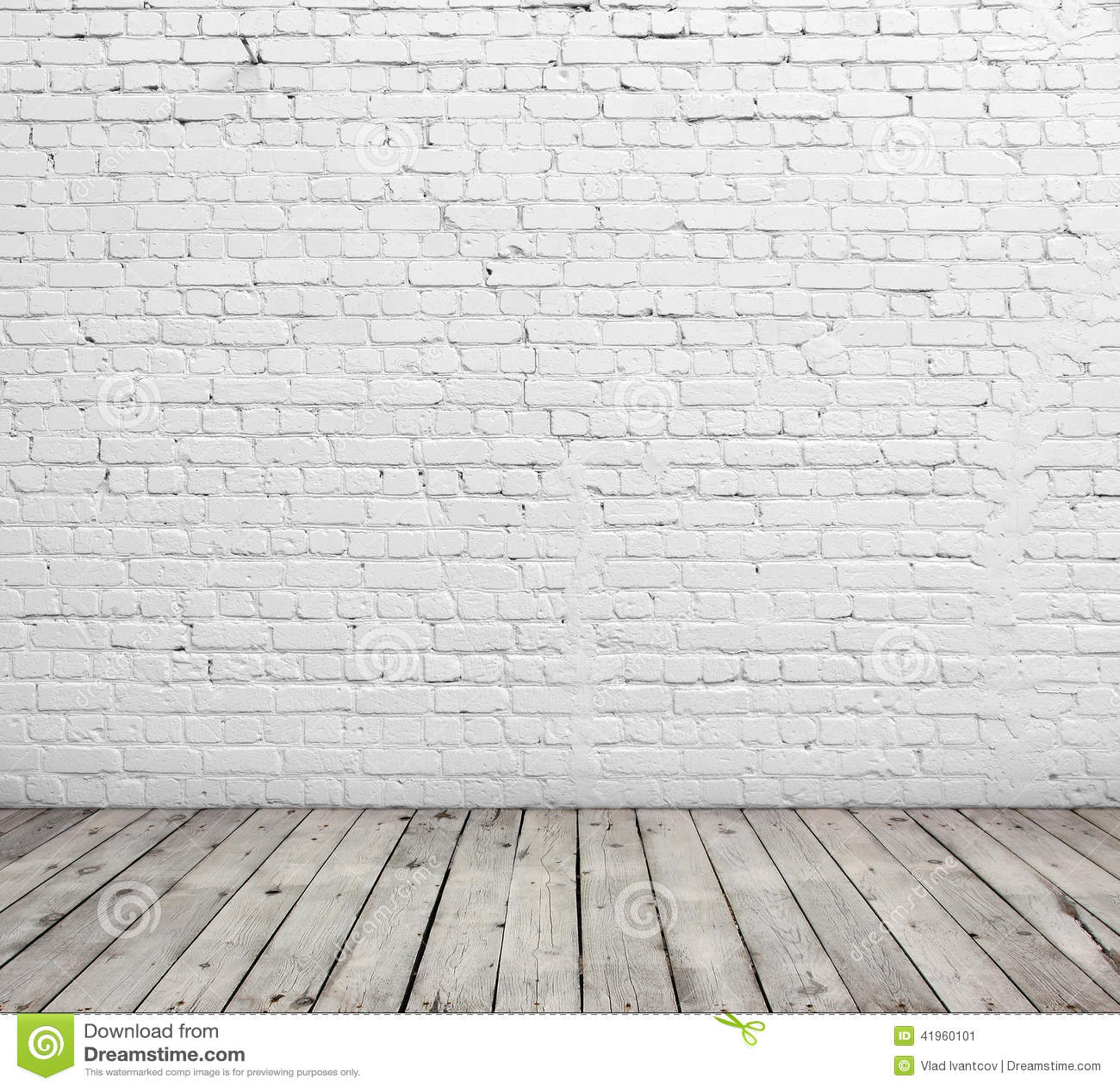 Witte bakstenen muur en houten vloer