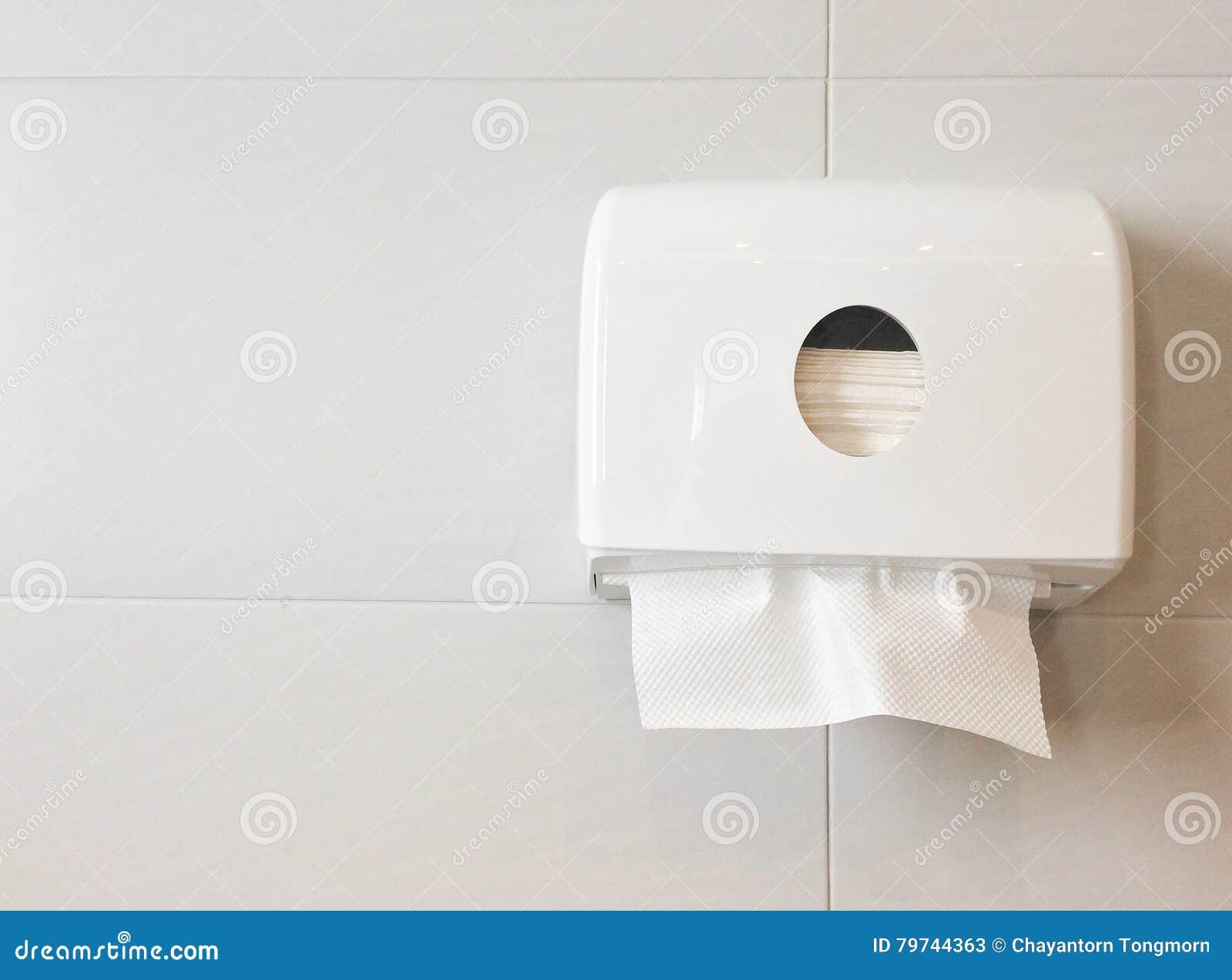 Witte doos weefsels op muur in toilet