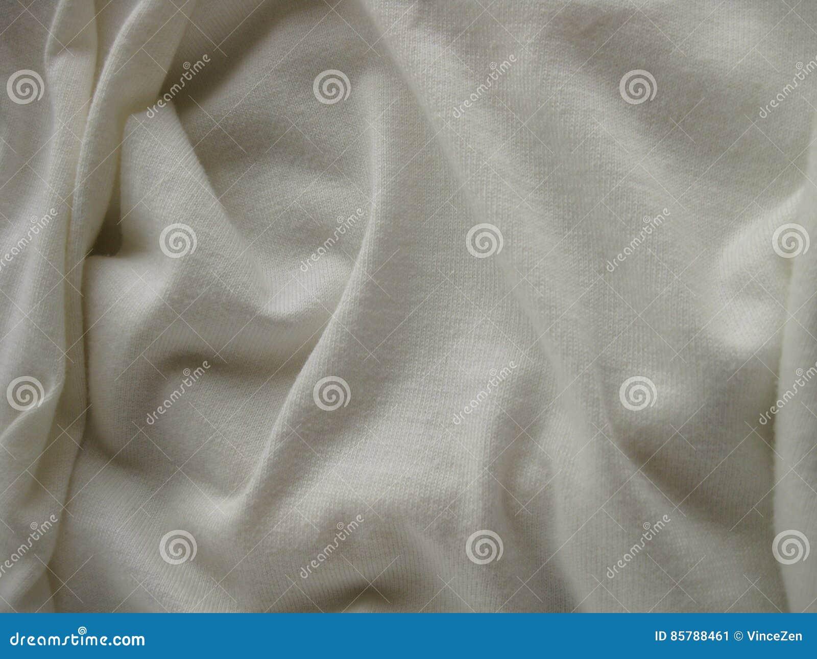 Witte geweven doekachtergrond met zachte, het buigen vouwen en exemplaarruimte