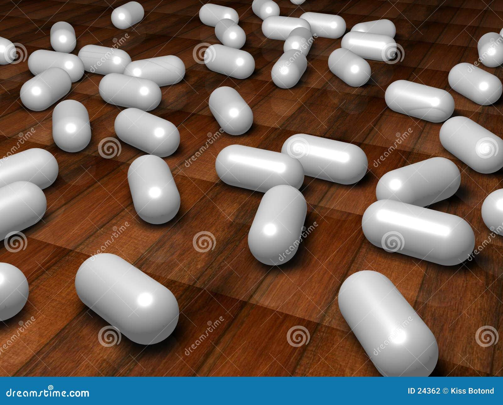 Witte pillen op de vloer