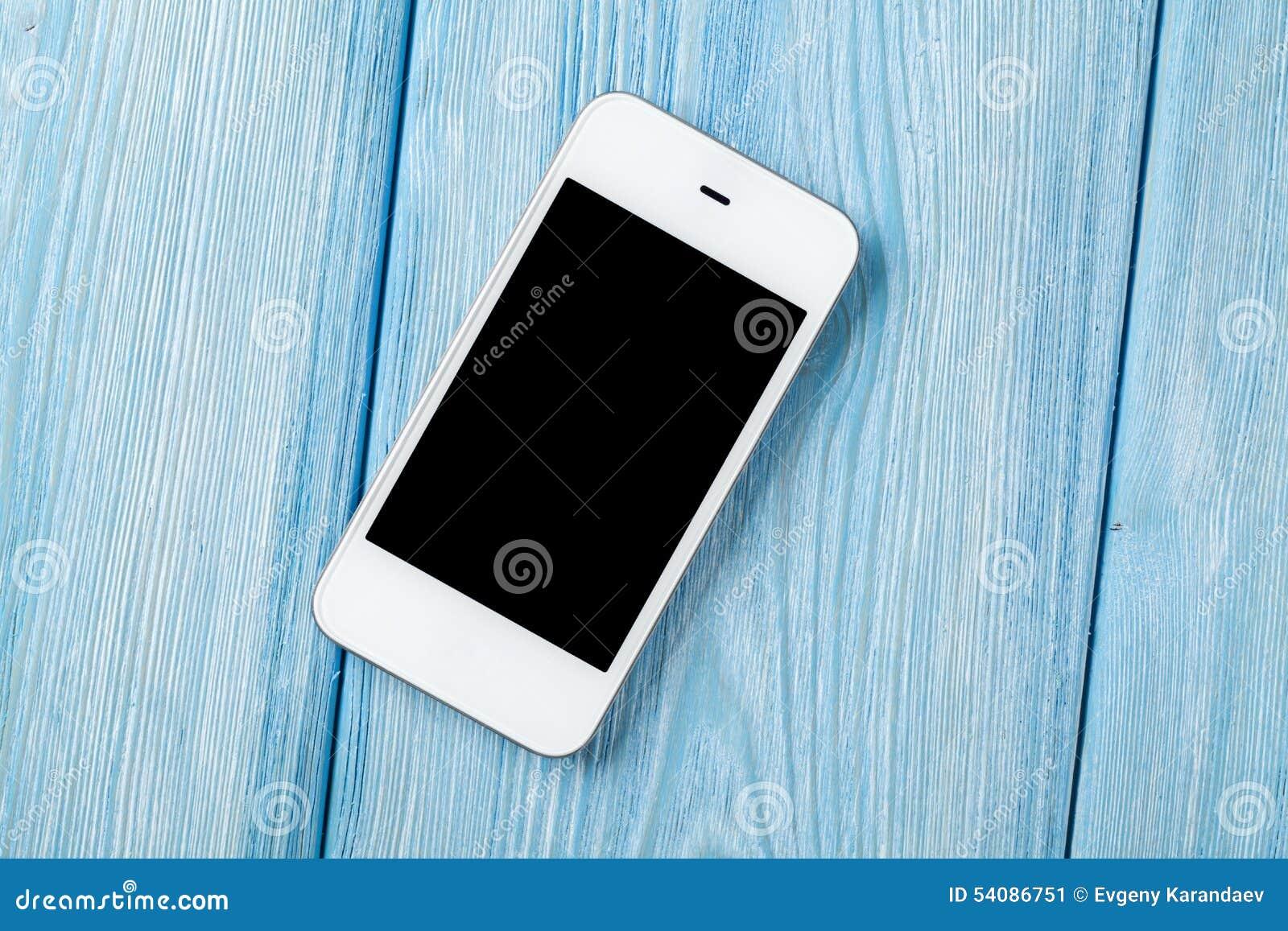 Witte smartphone op houten lijst