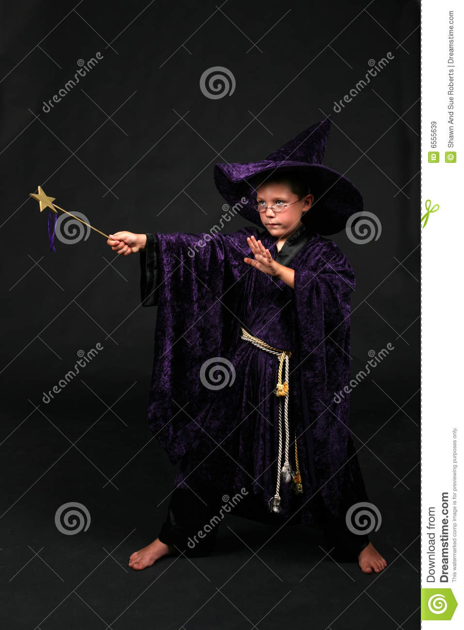 Wizard Boy With Magic Wand Casting A Spell Royalty Free Stock ...