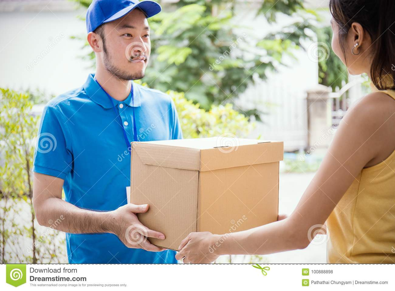 Woman accepting receive a delivery of boxes from delivery asian man