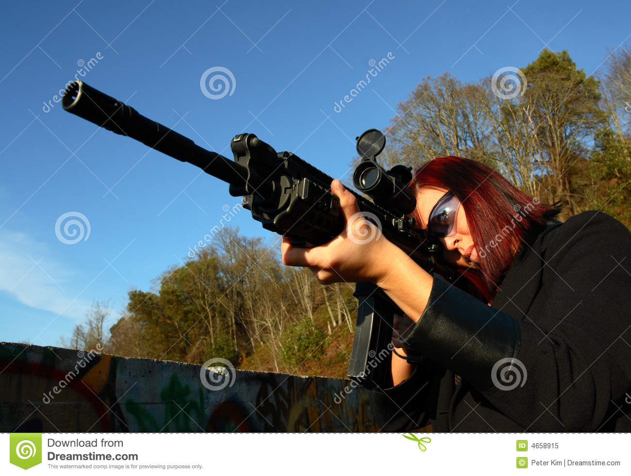 Us marine corps soldier holding m4 assault rifle over brown background - Young Woman Aiming Assault Rifle Stock Photo