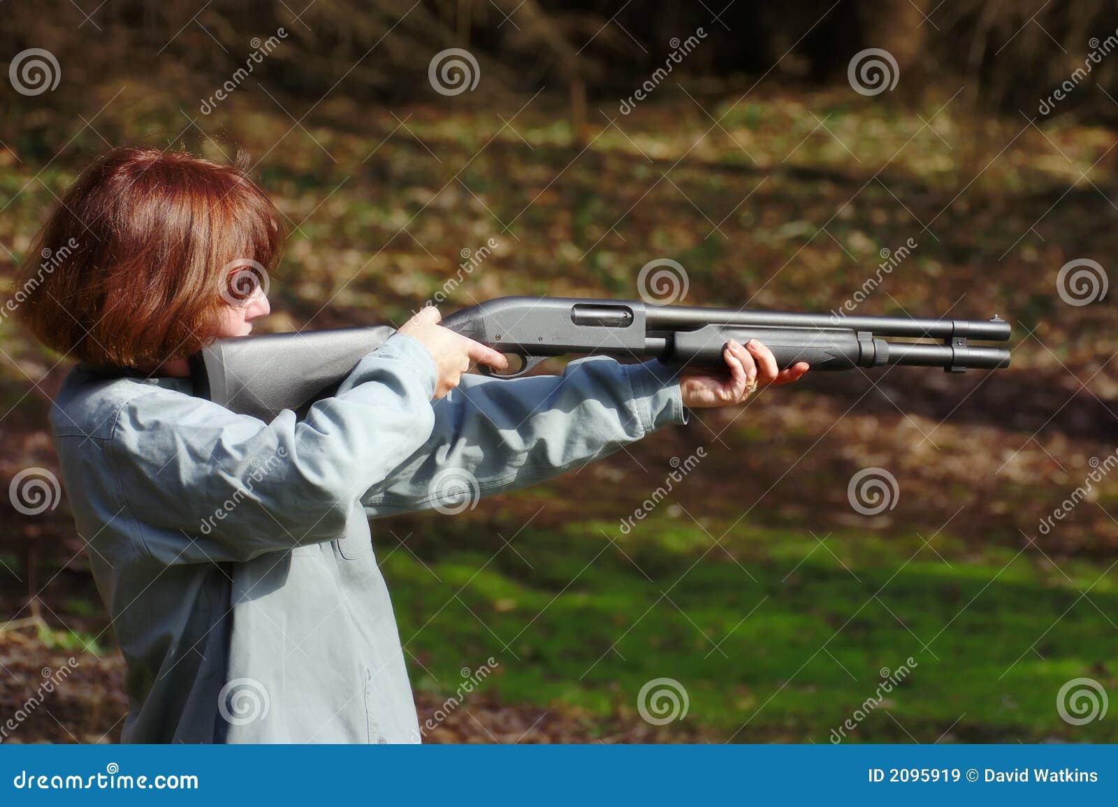Woman aiming a shotgun stock image. Image of firearm ...