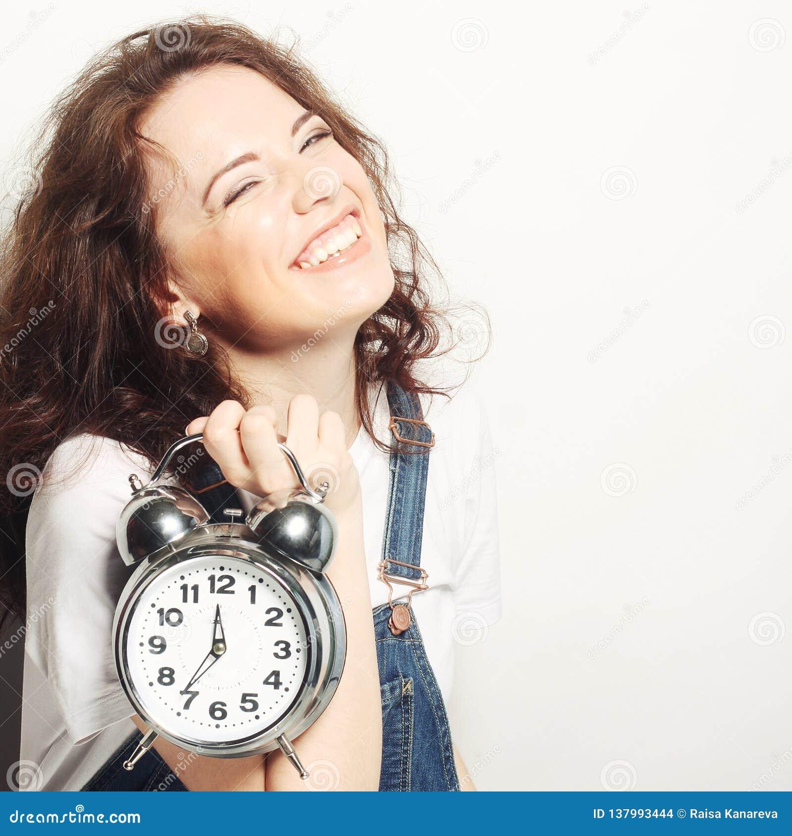 Woman with alarmclock