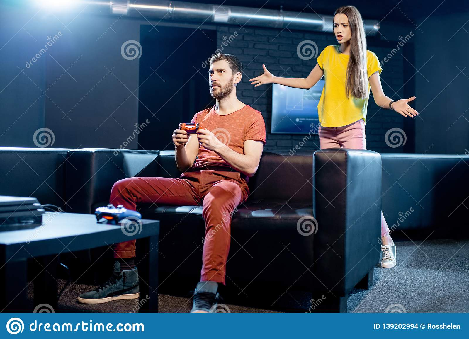 Woman angry at her boyfriend playing video games