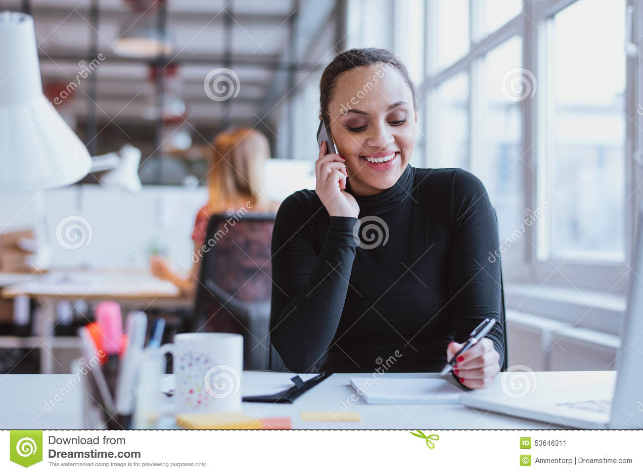 Woman Answering A Phone Call While At Work Stock Image ...