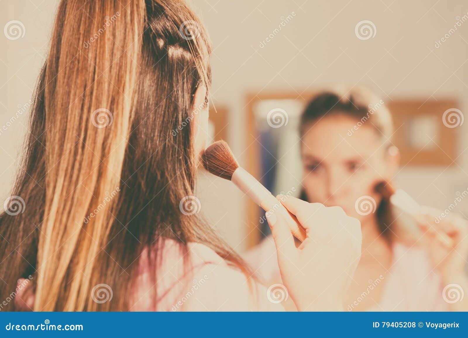 Woman Applying Bronzing Powder With Brush To Her Skin Woman Applying  Bronzing Powder With Brush To