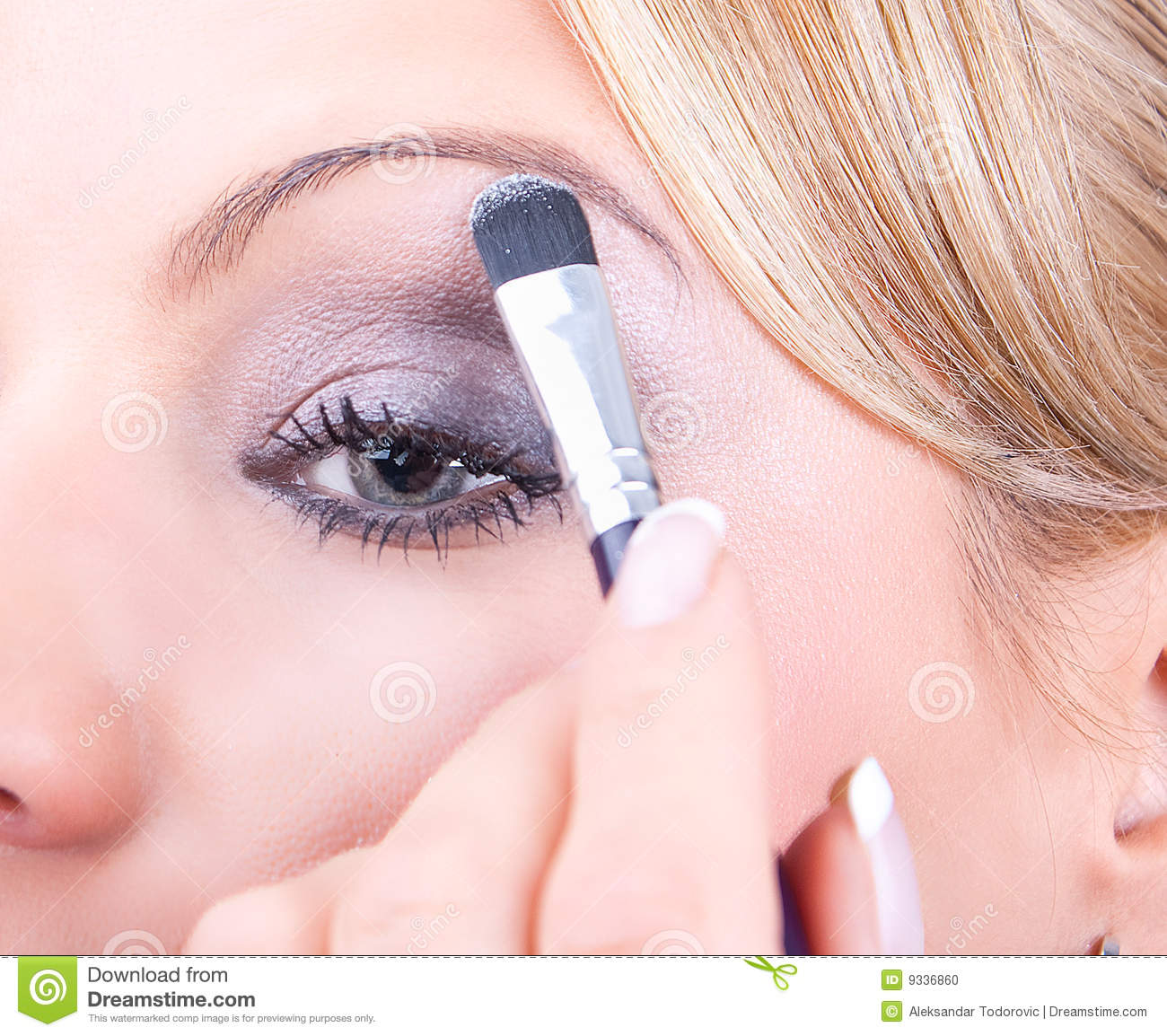 Woman applying cosmetic with applicator