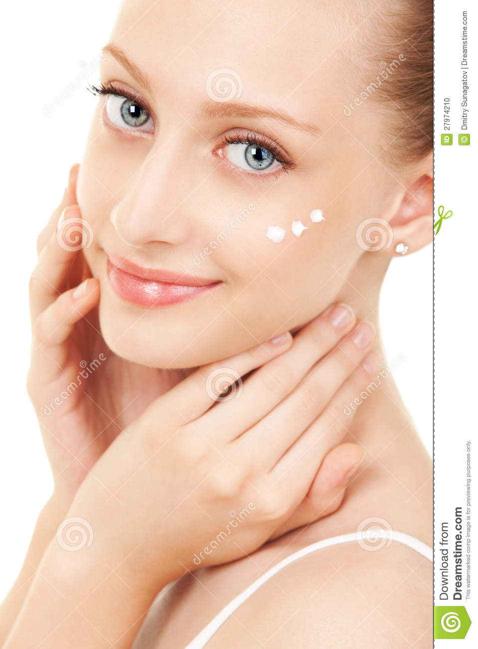 Woman Applying Cream To Her Face Stock Photo Image 27974210