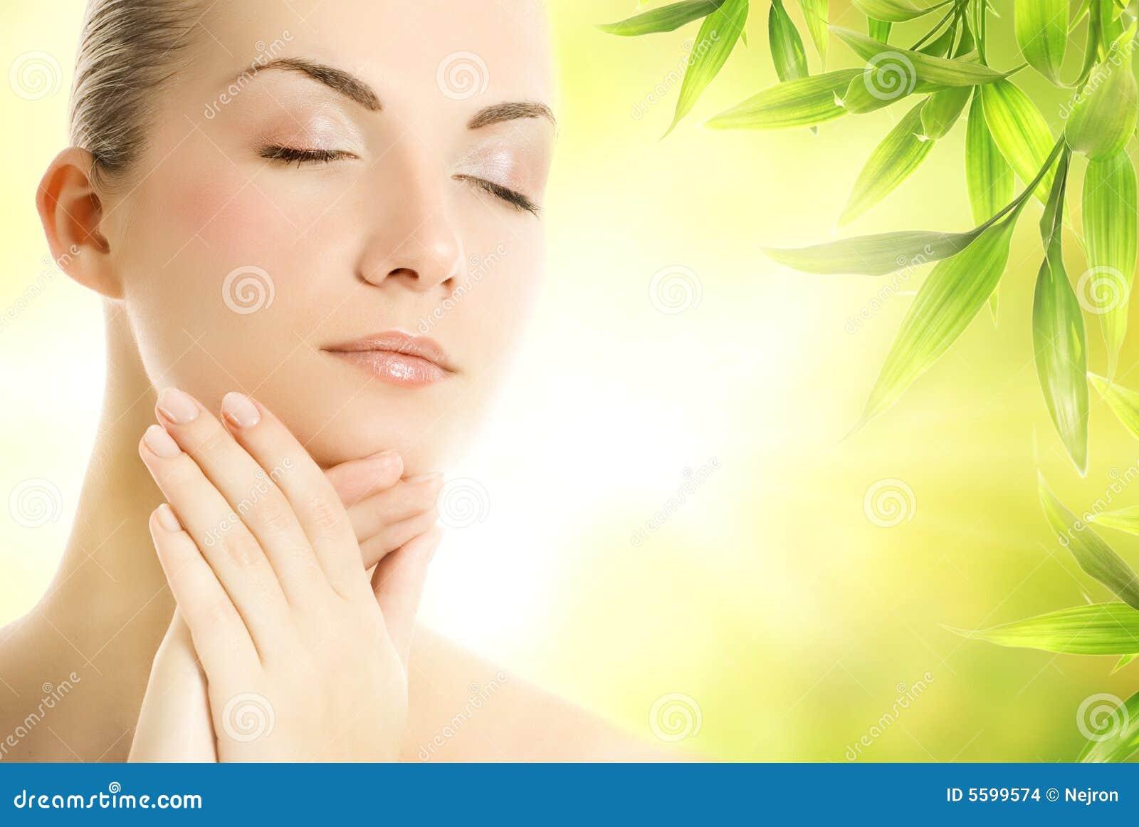Woman applying organic cosmetics to her skin