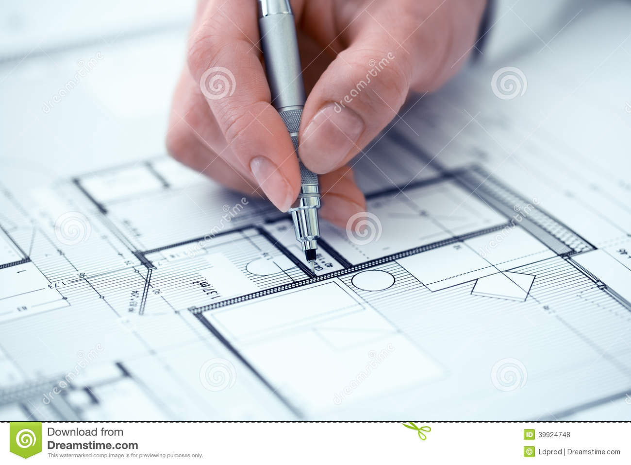 Woman architect drawing on print construction project stock photo royalty free stock photo malvernweather Choice Image