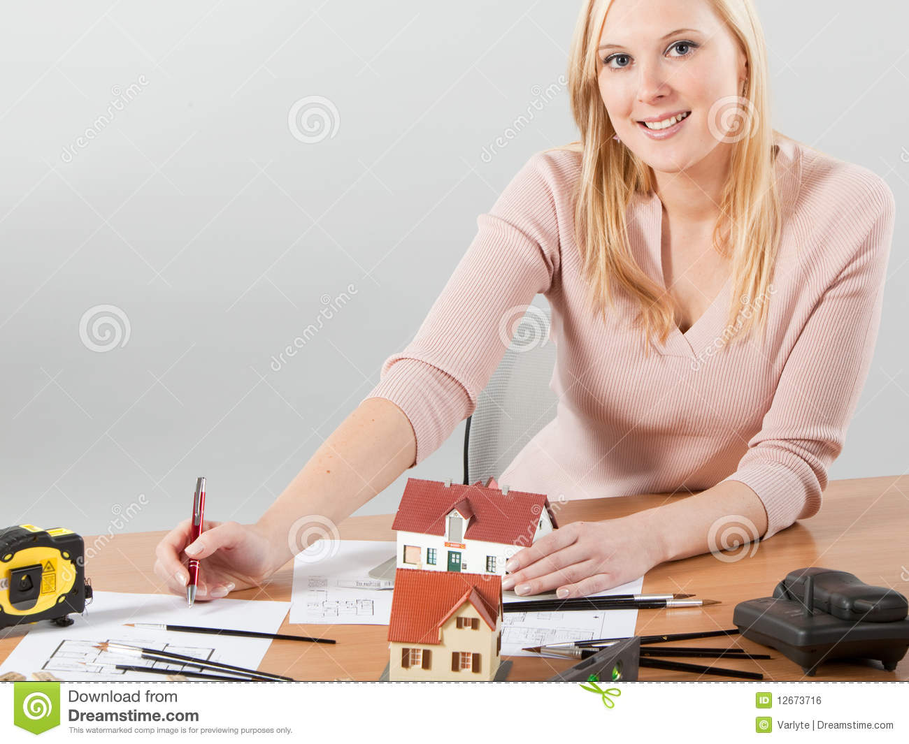 Woman architect at her work table royalty free stock image for Architect at work