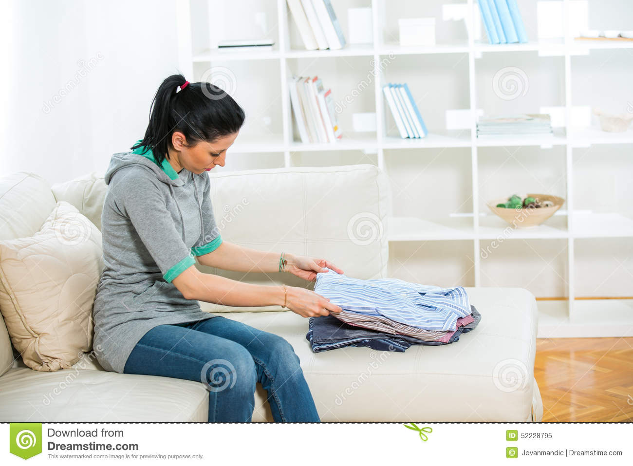 Woman Arrange Shirts In Living Room Stock Image - Image of person ...