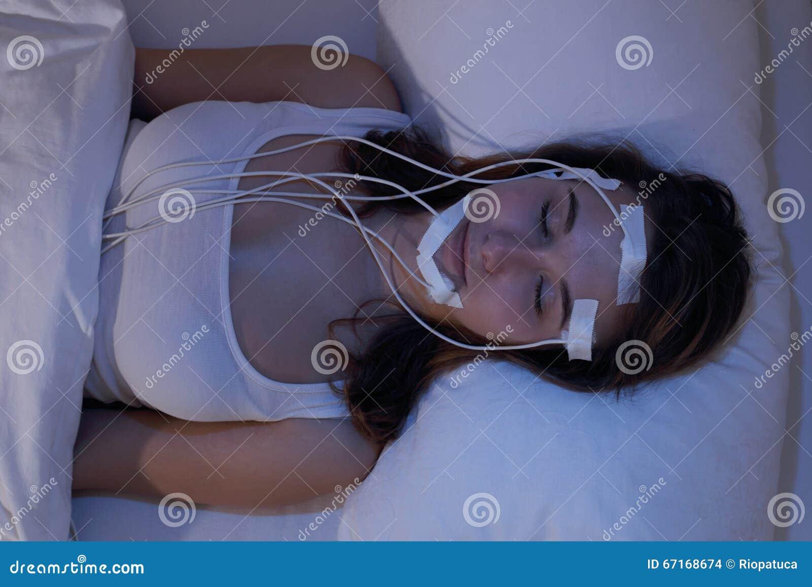 Woman asleep measering brainwaves eg in a Sleep Lab