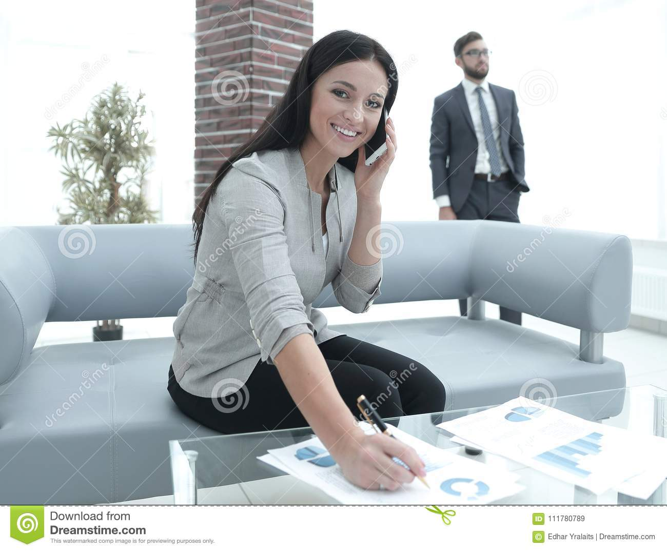 Woman assistant at the workplace in the office
