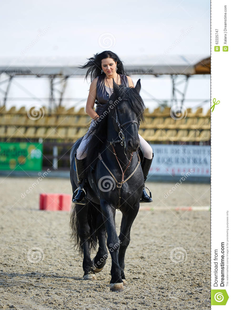 Woman astride a horse