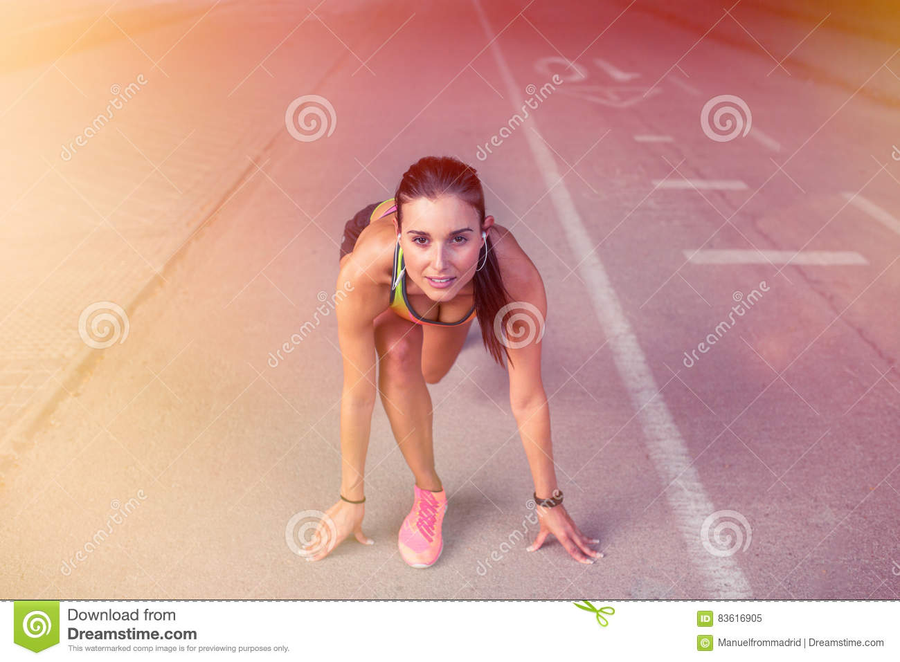 Woman Athlete In The Ready Set Go Position To Start Running Training Race