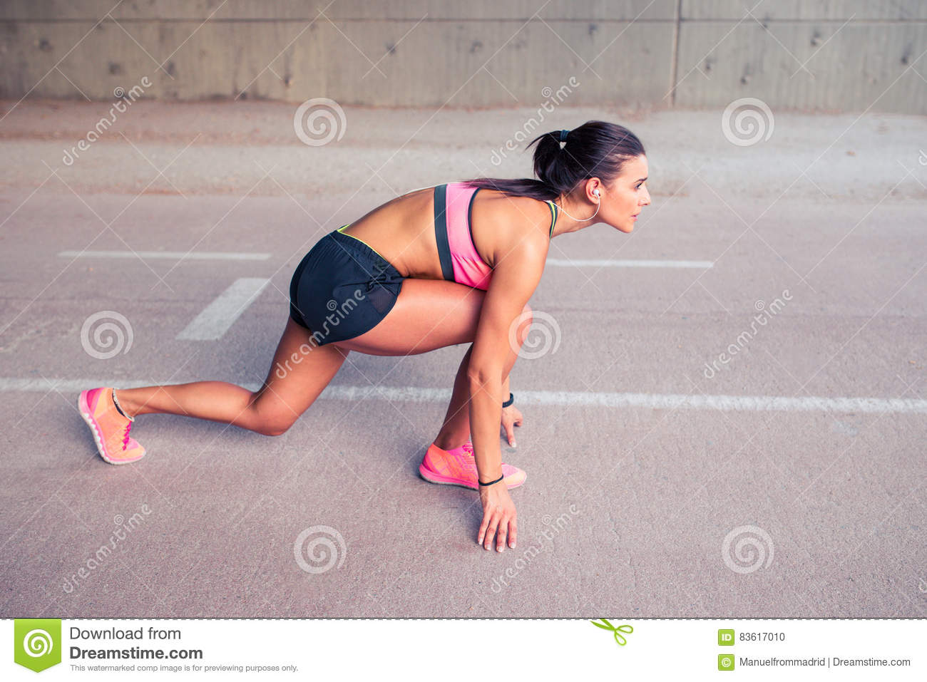 Woman Athlete In The Ready Set Go Position To Start Running Sport Determination