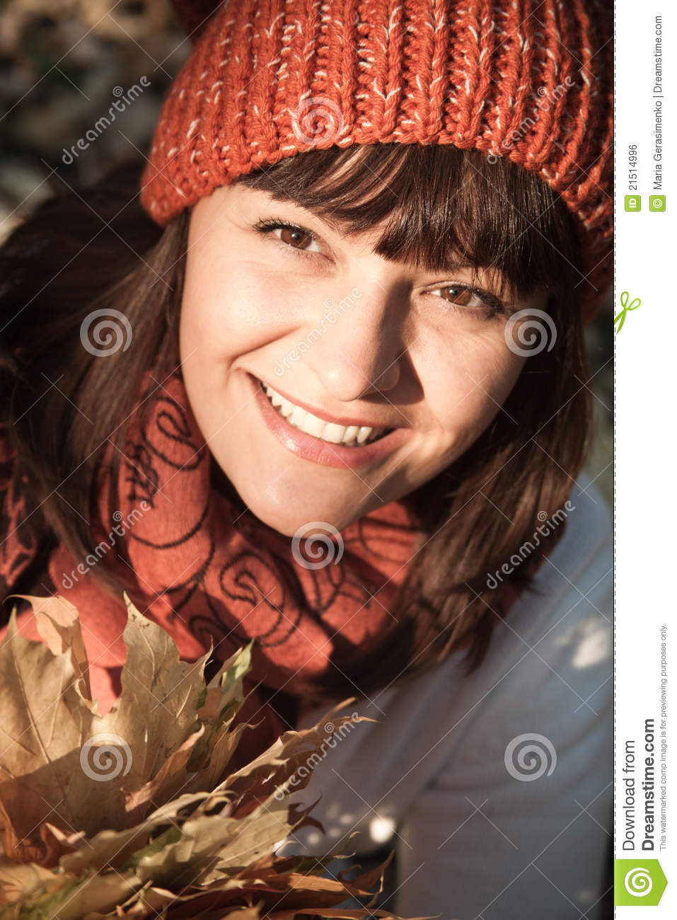 Woman with autumn orange leaves