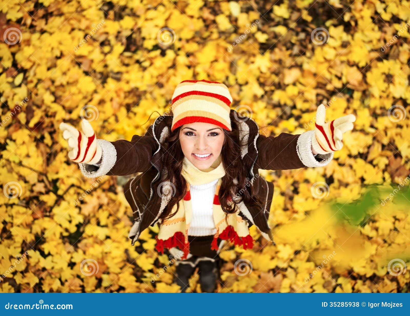 Woman in autumn orange leaves, outdoor